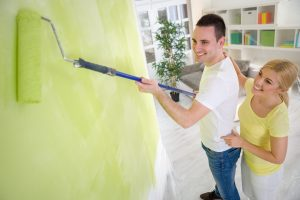 Couple painting their new home DIY