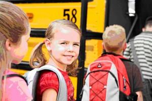 kids waiting to get on school bus